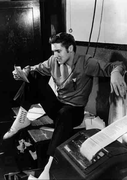 Elvis in the Newsroom next to news teletype